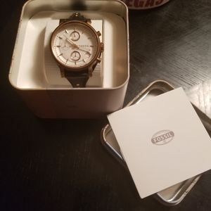 Fossil watch with leather straps and gold accents